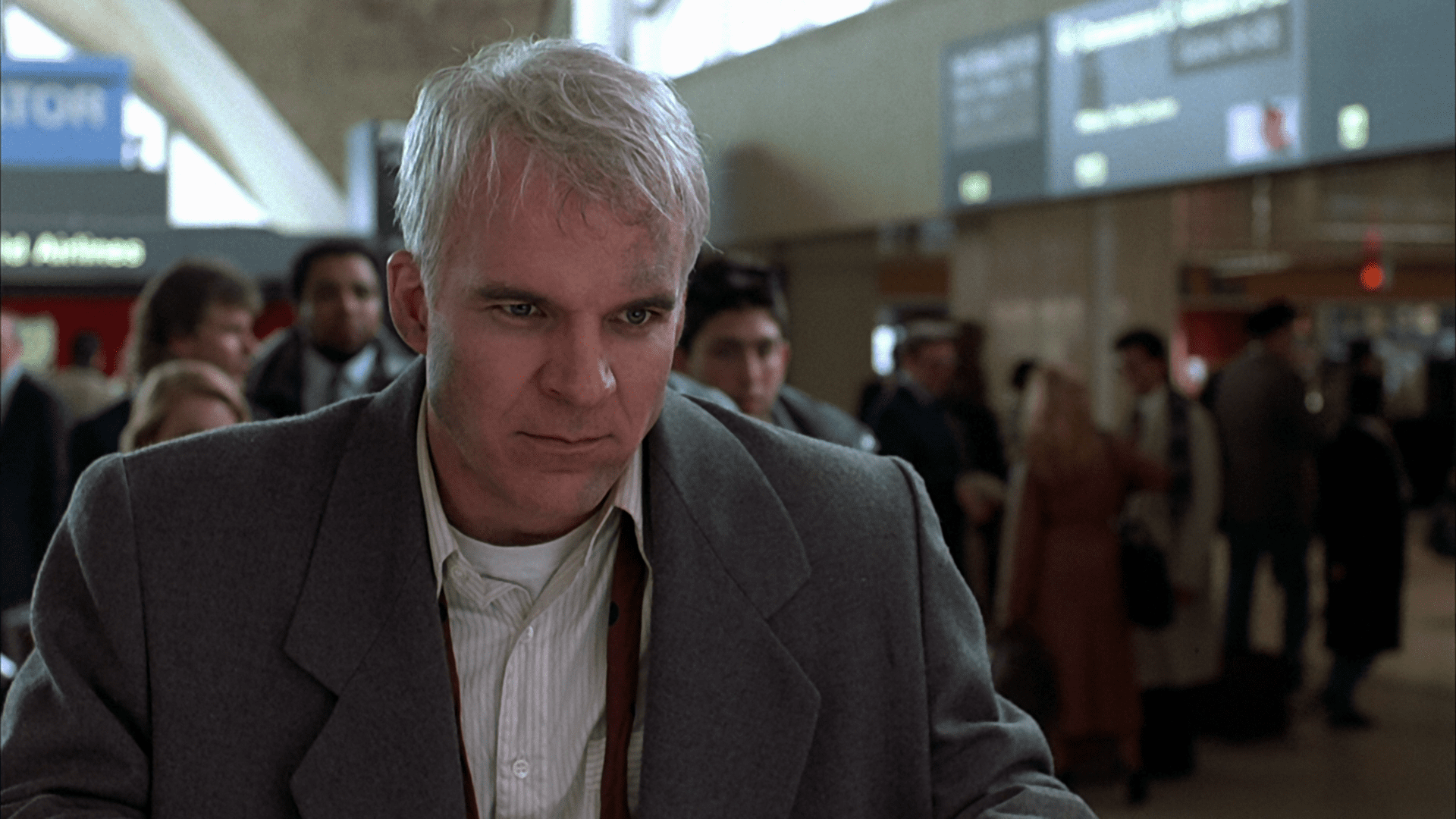 Steve Martin as Neal Page in Planes Trains and Automobiles by John Hughes which is a movie I'm mentioning for SEO Juice.